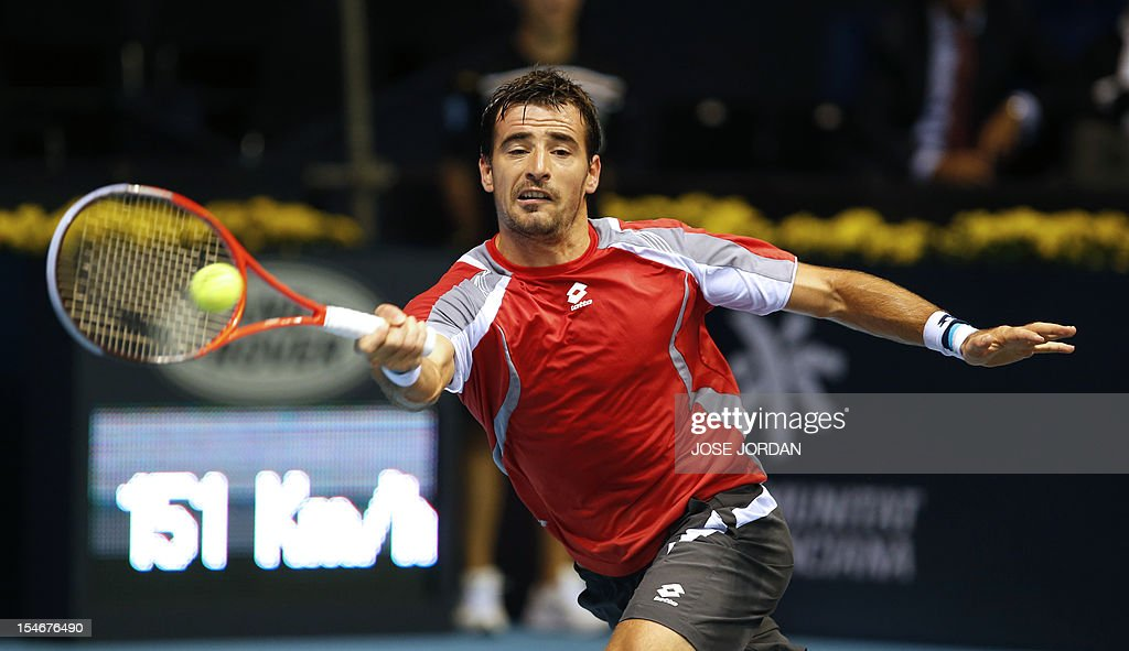 Croatia's Ivan Dodig returns the ball to Australia's Lleyton Hewitt during their tennis match at the Open 500 Valencia at the Agora space in Valencia, on October 24, 2012. AFP PHOTO / JOSE JORDAN
