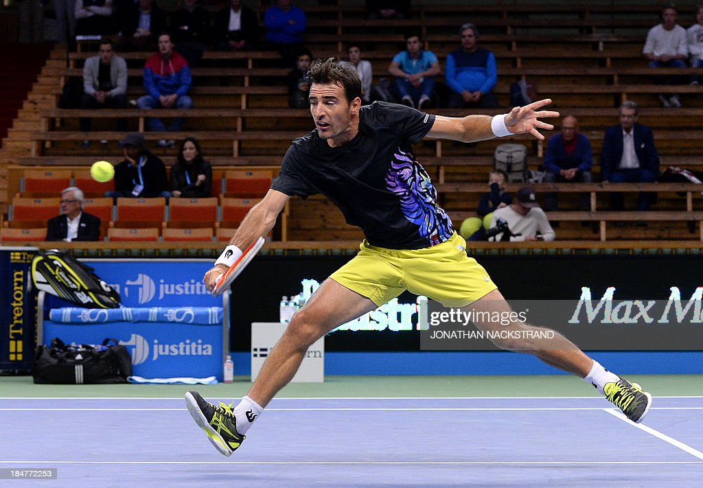Croatia's Ivan Dodig returns the ball to Spain's Fernando Verdasco during the ATP Stockholm Open tennis tournament on October 16, 2013 in Stockholm.