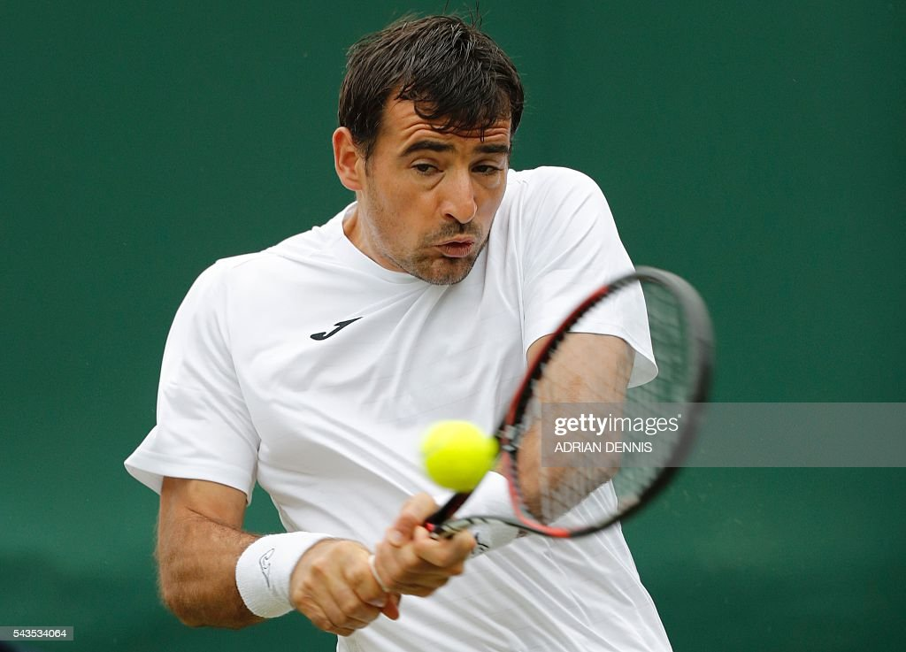 Croatia's Ivan Dodig returns to Czech Republic's Tomas Berdych during a men's singles first round match on the third day of the 2016 Wimbledon Championships at The All England Lawn Tennis Club in Wimbledon, southwest London, on June 29, 2016. / AFP / ADRIAN