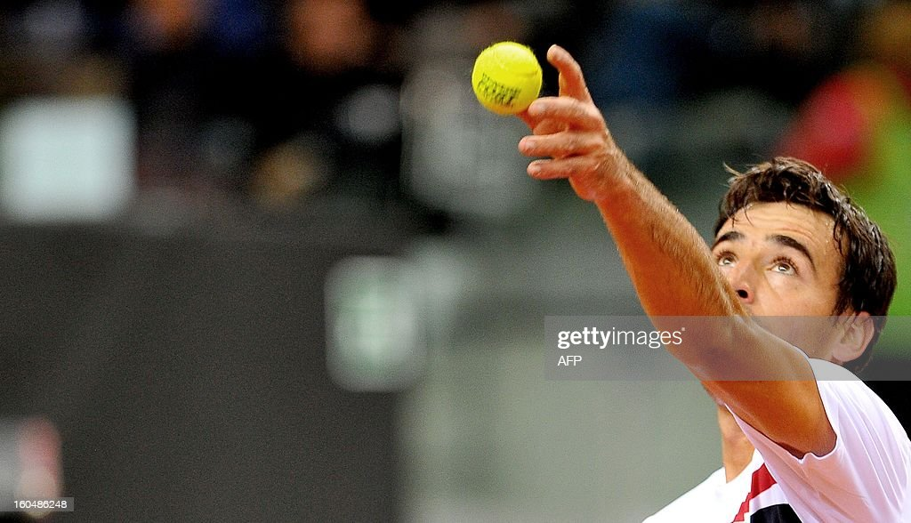 Croatia's Ivan Dodig serves a ball to Italy's Italian Andreas Seppi during their Davis Cup first round match on February 1, 2013.