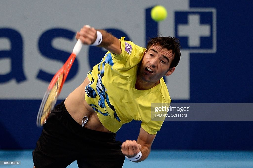Croatia's Ivan Dodig serves during his quarter final match against Canada's Vasek Pospisil at the Swiss Indoors ATP tennis tournament on October 25, 2013 in Basel.