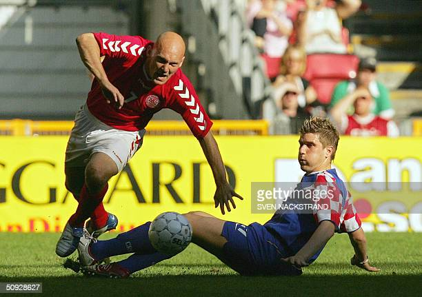 Croatia's Ivan Klasnic brings down Denmark's Thomas Gravesen in the preEURO 2004 friendly football match between the two countries in Copenhagen 05...