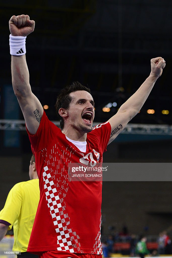 Croatia's Ivan Nincevic celebrates their victory at the end of the 23rd Men's Handball World Championships bronze medal match Slovenia vs Croatia at the Palau Sant Jordi in Barcelona on January 26, 2013. Croatia won 31-26. AFP PHOTO/ JAVIER SORIANO