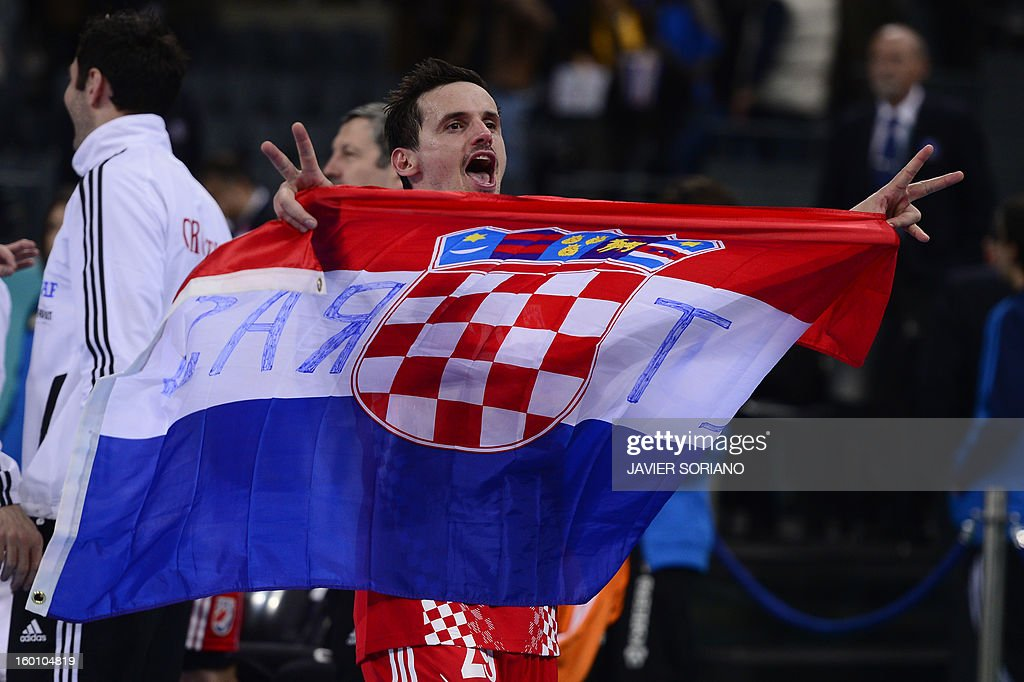 Croatia's Ivan Nincevic celebrates with his national flag their victory at the end of the 23rd Men's Handball World Championships bronze medal match Slovenia vs Croatia at the Palau Sant Jordi in Barcelona on January 26, 2013. Croatia won 31-26. AFP PHOTO/ JAVIER SORIANO