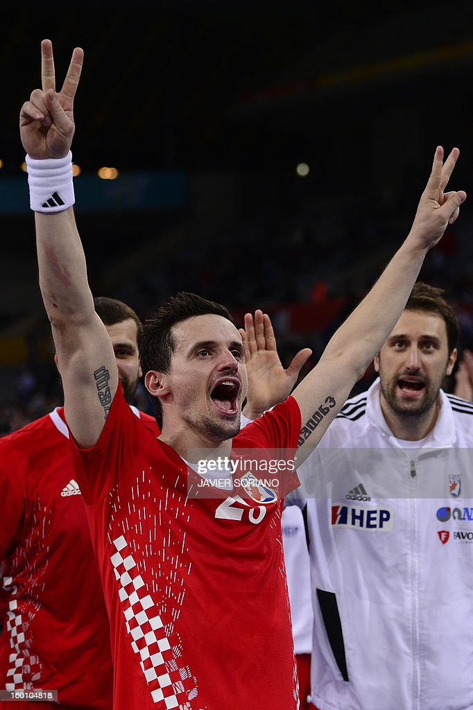 Croatia's Ivan Nincevic celebrates with teammates their victory at the end of the 23rd Men's Handball World Championships bronze medal match Slovenia vs Croatia at the Palau Sant Jordi in Barcelona on January 26, 2013. Croatia won 31-26.