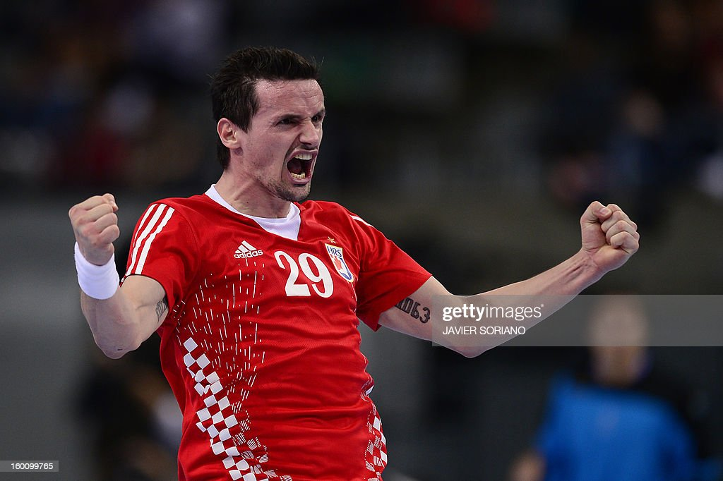 Croatia's Ivan Nincevic reacts after scoring during the 23rd Men's Handball World Championships bronze medal match Slovenia vs Croatia at the Palau Sant Jordi in Barcelona on January 26, 2013. Croatia won 31-26. AFP PHOTO/ JAVIER SORIANO
