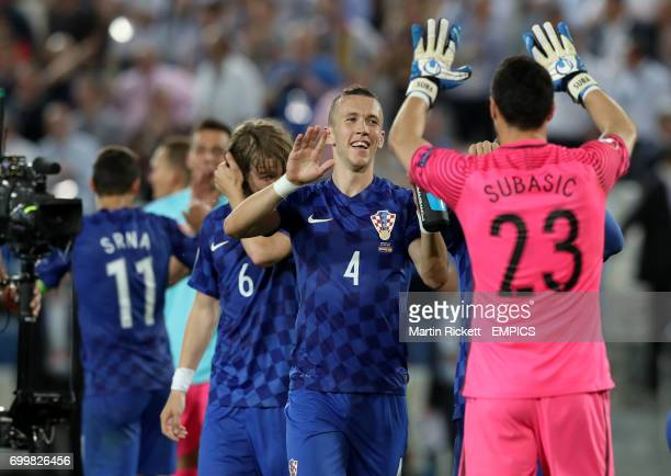 Croatia's Ivan Perisic and goalkeeper Danijel Subasic celebrate after the final whistle
