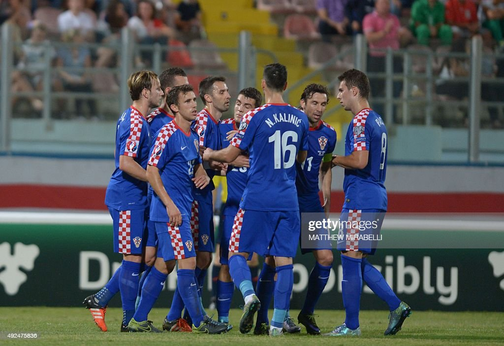 Croatia's Ivan Perisic celebrates with teammates after scoring during the Euro 2016 qualifying football match between Malta and Croatia on October 13...