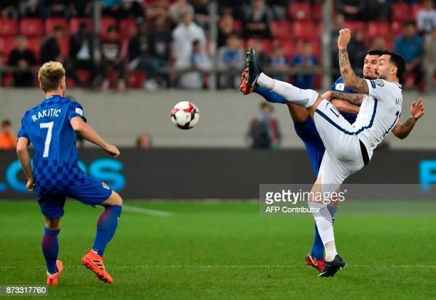 Croatia's Ivan Rakitic vies with Konstantinos Mitroglou during the World Cup 2018 playoff football match Greece vs Croatia on November 12 2017 in...