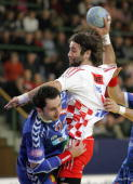 Croatia's Ivano Balic vies against Serbia and Montenegro's Alem Toskic during their game at the main round of the European handball Championships 2...