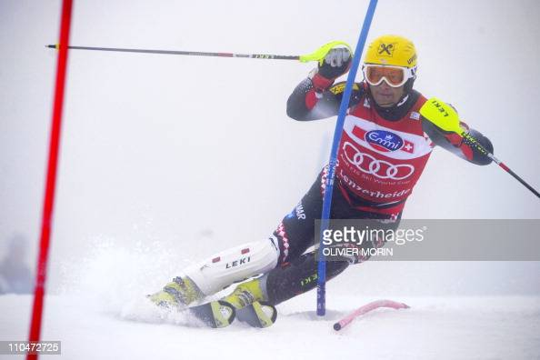 Croatia's Ivica Kostelic clears a gate to clock the best time during the first run og the men's slalom race in the Alpine Ski World Cup finals on...