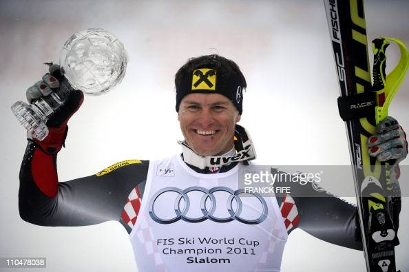 Croatia's Ivica Kostelic holds the Ski World Cup Crystal Globe winner trophy at the men's slalom standing after the season's last slalom race in the...