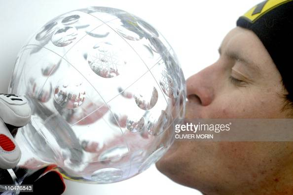Croatia's Ivica Kostelic kisses his Ski World Cup Crystal Globe winner trophy after the season's men last slalom race in the Alpine Ski World Cup...