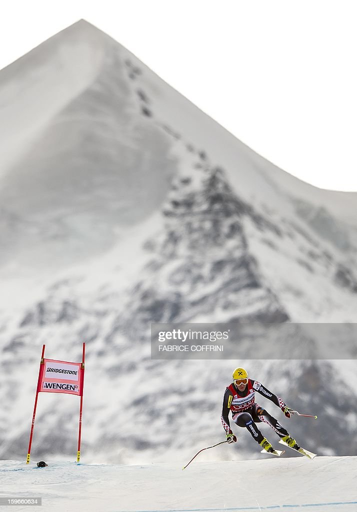 Croatia's Ivica Kostelic leaps on January 18, 2013 in front of the Silberhorn mountain during the downhill event of the men's super combined of the FIS Alpine Skiing World Cup in Wengen.
