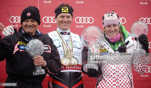 Croatia's Ivica Kostelic poses with his father Ante and sister Janica during the Ski World Cup Crystal Globe trophy ceremony in the Alpine Ski World...