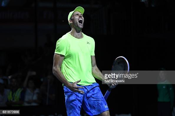 TOPSHOT Croatia's Ivo Karlovic celebrates his victory against Argentina's Horacio Zeballos during their men's singles match on day two of the...