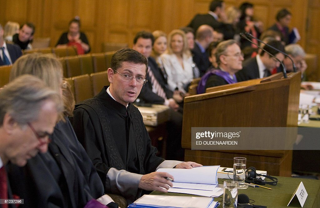 Croatia's lawyer, Ivan Simonovic (3rd L), and Serbia's counsel Tibor Varady (4th L) attend on May 26, 2008 in The Hague the International Court of Justice hearing of a complaint filed in 1999 by Croatia against Serbia, alleging a program of 'ethnic cleansing' during the 1991-1995 war in Croatia was directly controlled from Belgrade. Serbia argued before the UN's highest court on May 26, 2008 that crimes committed in the early 1990s war in Croatia did not amount to an act of genocide as alleged a complaint filed by Zagreb. AFP PHOTO / ED OUDENAARDEN -Netherlands out - Belgium out-