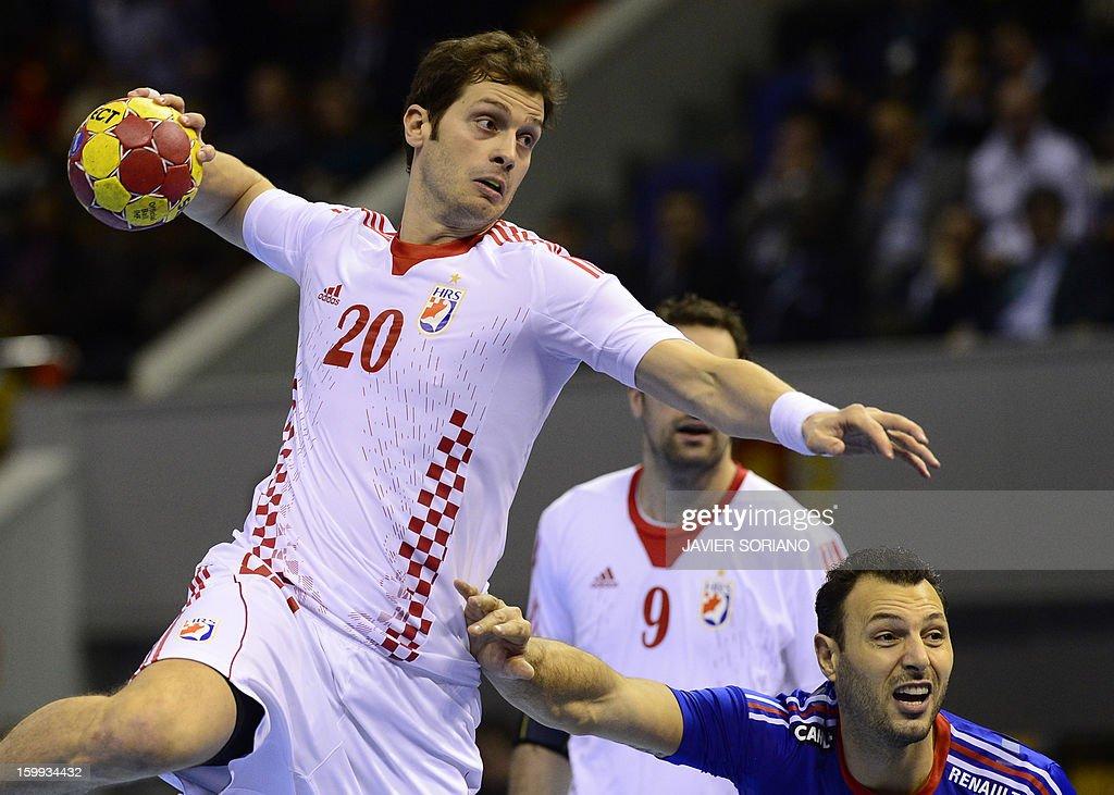 Croatia's left back Damir Bicanic vies with France's left wing Jerome Fernandez during the 23rd Men's Handball World Championships quarterfinal match...