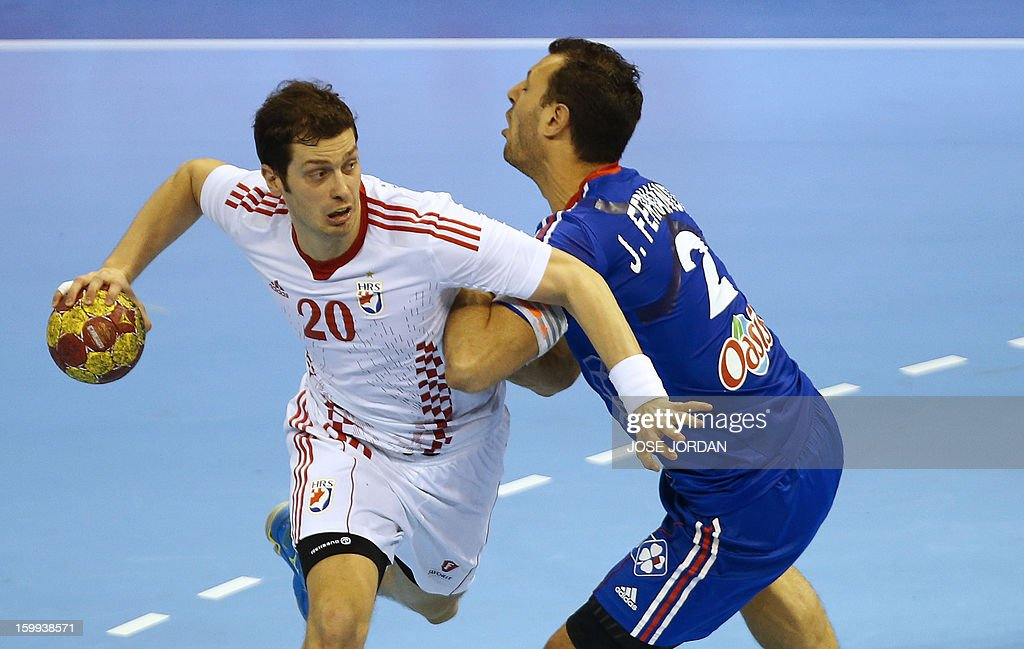 Croatia's left back Damir Bicanic (L) vies with France's left wing Jerome Fernandez during the 23rd Men's Handball World Championships quarterfinal match France vs Croatia at the Pabellon Principe Felipe in Zaragoza on January 23, 2013. Croatia won 30-23.
