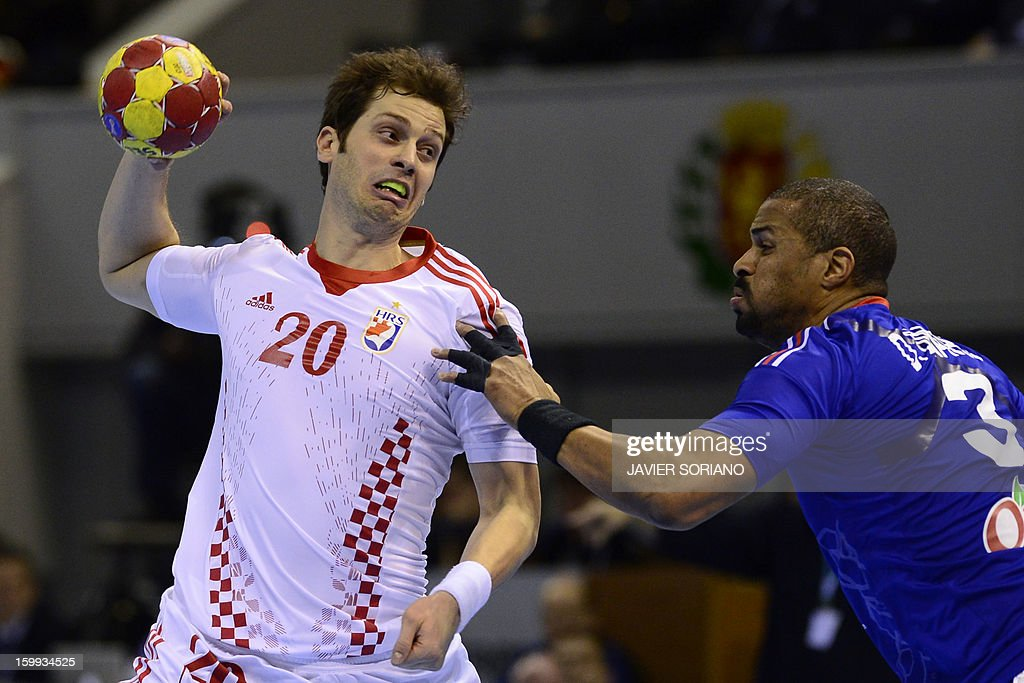 Croatia's left back Damir Bicanic vies with France's pivot Didier Dinart during the 23rd Men's Handball World Championships quarterfinal match France...