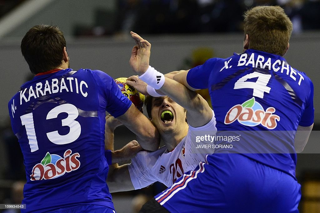 Croatia's left back Damir Bicanic vies with France's right back Xavier Barachet and France's centre back Nikola Karabatic during the 23rd Men's...