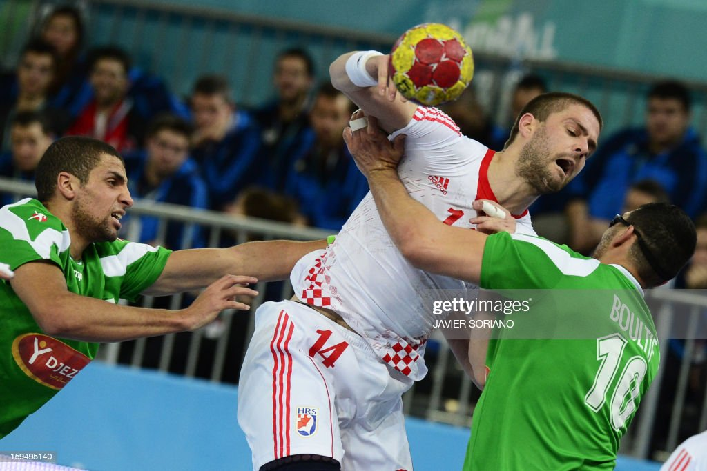Croatia's left back Drago Vukovic (C) vies with Algeria's centre back Hichem Daoud (L) and Algeria's right back Sassi Boultif (R) during the 23rd Men's Handball World Championships preliminary round Group D match Algeria vs Croatia at the Caja Magica in Madrid on January 14, 2013.