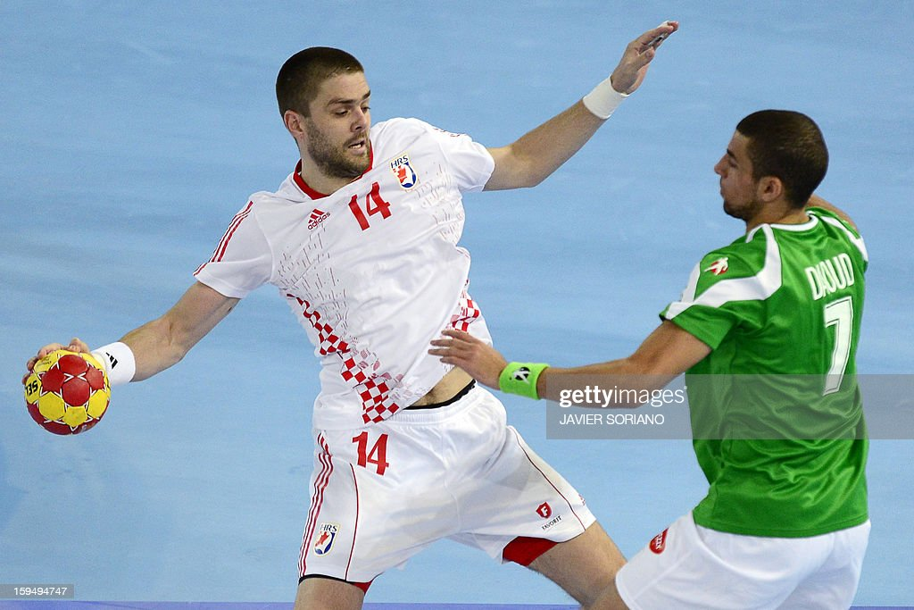 Croatia's left back Drago Vukovic (L) vies with Algeria's centre back Hichem Daoud (R) during the 23rd Men's Handball World Championships preliminary round Group D match Algeria vs Croatia at the Caja Magica in Madrid on January 14, 2013.