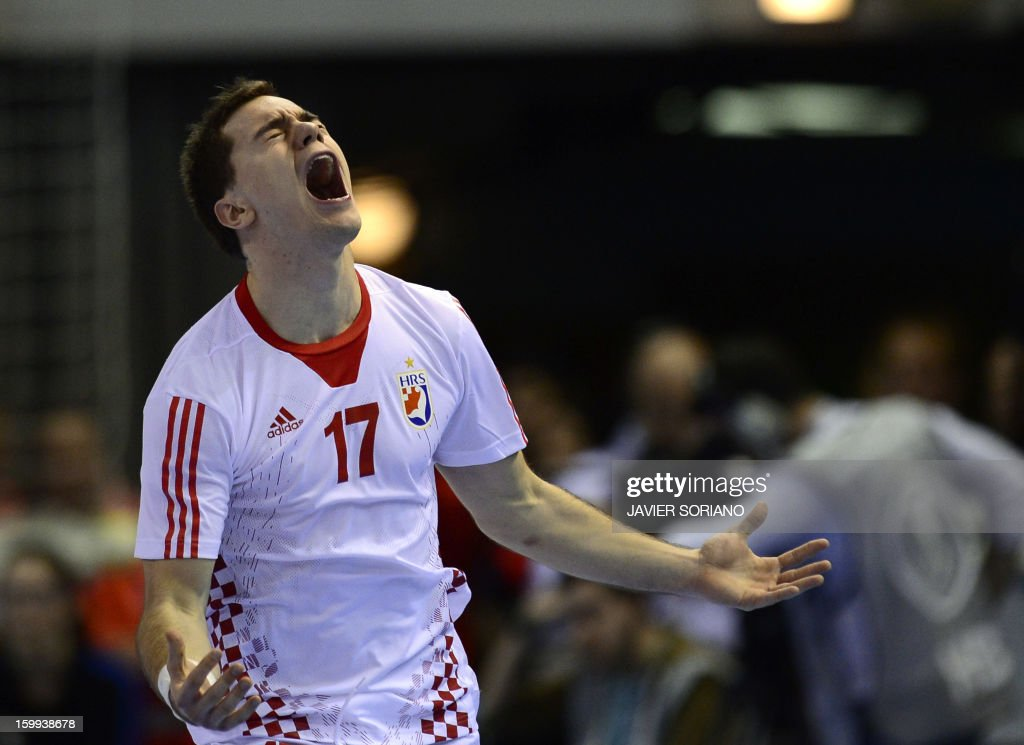 Croatia's left wing Lovo Sprem reacts at the end of the 23rd Men's Handball World Championships quarterfinal match France vs Croatia at the Pabellon...
