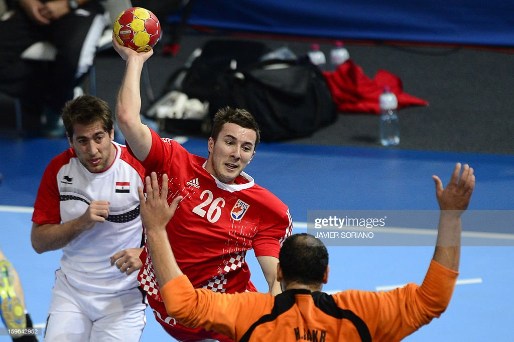 Croatia's left wing Manuel Strlek (C) shoots as he vies with Egypt's right wing Mohamed Hisham (L) and Egypt's goalkeeper Hady Mohamed (R) during the 23rd Men's Handball World Championships preliminary round Group D match Croatia vs Egypt at the Caja Magica in Madrid on January 17, 2013.
