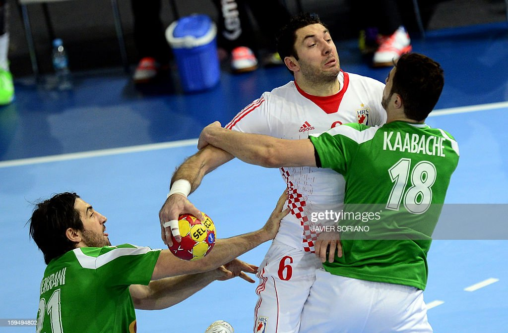 Croatia's leftback Blazenko Lackovic (C) vies with Algeria's pivot Mohamed Aski Mokrani (L) and Algeria's pivot Hichem Kaabeche (R) during the 23rd Men's Handball World Championships preliminary round Group D match Algeria vs Croatia at the Caja Magica in Madrid on January 14, 2013.