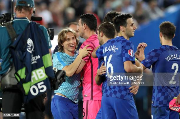 Croatia's Luka Modric celebrates with team mates after the final whistle