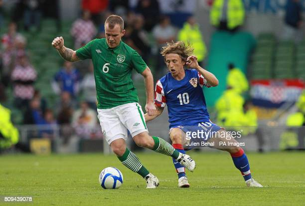 Croatia's Luka Modric in action with Republic of Ireland's Glenn Whelan during the International Friendly at the Aviva Stadium Dublin