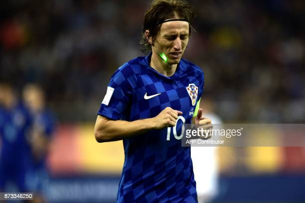 Croatia's Luka Modric reacts while being aimed by a laser during the World Cup 2018 playoff football match Greece vs Croatia on November 12 2017 in...