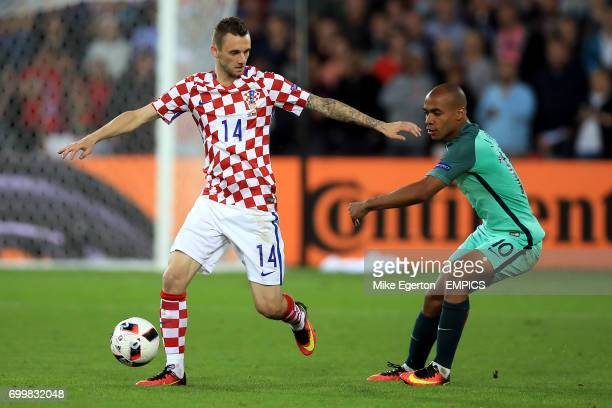 Croatia's Marcelo Brozovic and Portugal's Joao Mario battle for the ball