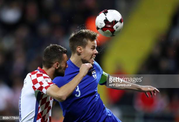 Croatia's Marcelo Brozovic fights for the ball with Finland's Niklas Moisander during the FIFA World Cup 2018 qualification football match between...