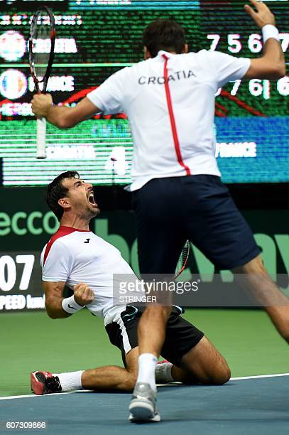 Croatia's Marin Cilic and Ivan Dodig celebrate their victory over France's PierreHugues Herbert and Nicolas Mahut during the Davis Cup World Group...