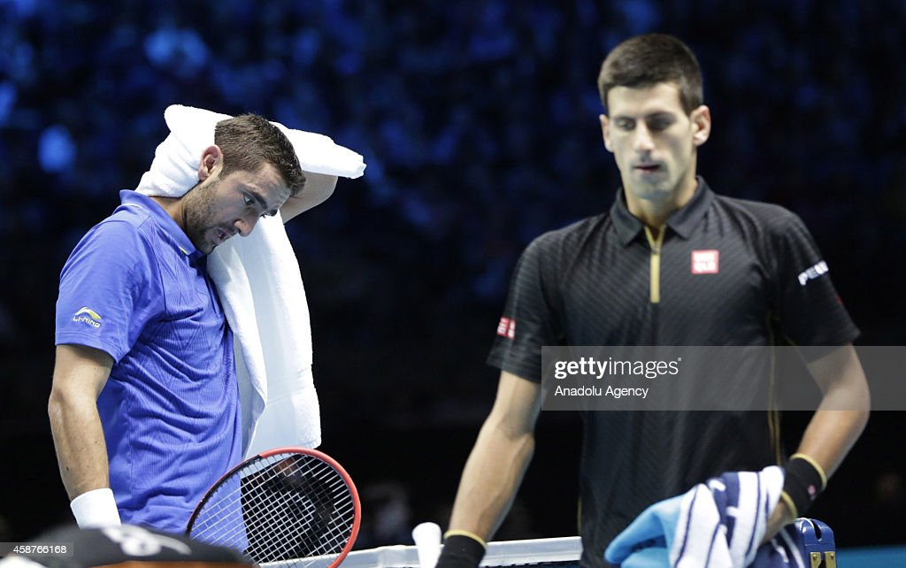 Croatia's Marin Cilic and Serbia's Novak Djokovic during their Group A singles match on day two of the ATP World Tour Finals tennis tournament at O2 Arena in London, England on November 10, 2014.