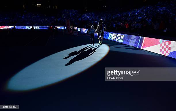 Croatia's Marin Cilic arrives on court for his Group A singles match against Switzerland's Stanislas Wawrinka on day six of the ATP World Tour Finals...
