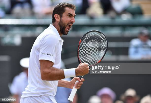 TOPSHOT Croatia's Marin Cilic celebrates winning the third set against Luxembourg's Gilles Muller during their men's singles quarterfinal match on...