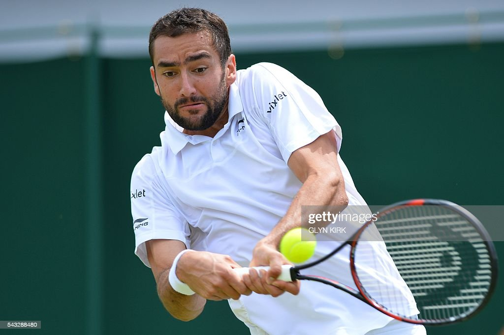 Croatia's Marin Cilic hits a return against US player Brian Baker during their men's singles first round match on the first day of the 2016 Wimbledon Championships at The All England Lawn Tennis Club in Wimbledon, southwest London, on June 27, 2016. / AFP / GLYN