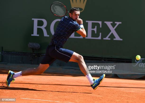 Croatia's Marin Cilic hits a return to Czech Republic's Tomas Berdych during their MonteCarlo ATP Masters Series tennis tournament on April 20 2017...