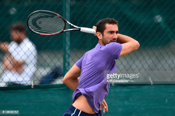 Croatia's Marin Cilic hits a shot as he attends a practice session at The All England Lawn Tennis Club in Wimbledon southwest London on July 13 2017...