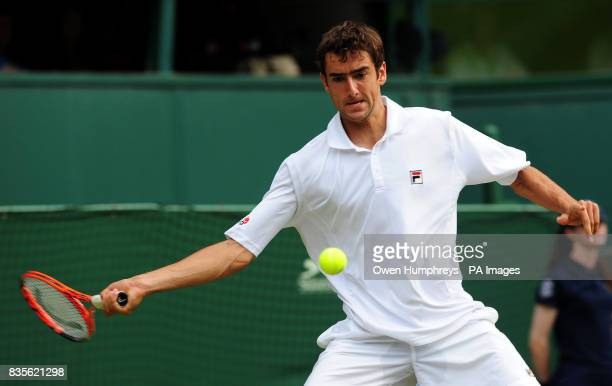 Croatia's Marin Cilic in action against USA's Sam Querrey during the 2009 Wimbledon Championships at the All England Lawn Tennis and Croquet Club...