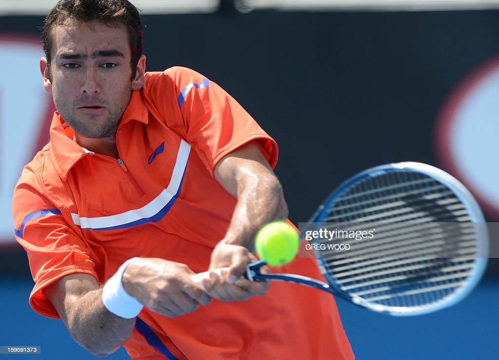 Croatia's Marin Cilic plays a return during his men's singles match against Rajeev Ram of the US on the fourth day of the Australian Open tennis tournament in Melbourne on January 17, 2013.