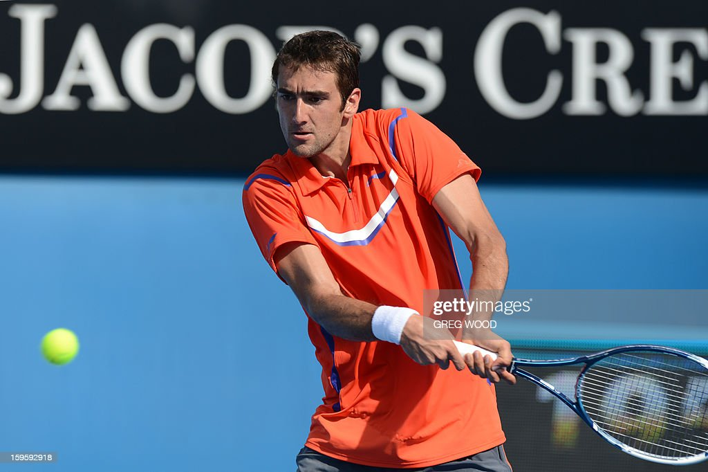 Croatia's Marin Cilic plays a return during his men's singles match against Rajeev Ram of the US on the fourth day of the Australian Open tennis tournament in Melbourne on January 17, 2013. AFP PHOTO/GREG WOOD IMAGE STRICTLY RESTRICTED TO EDITORIAL USE - STRICTLY NO COMMERCIAL USE