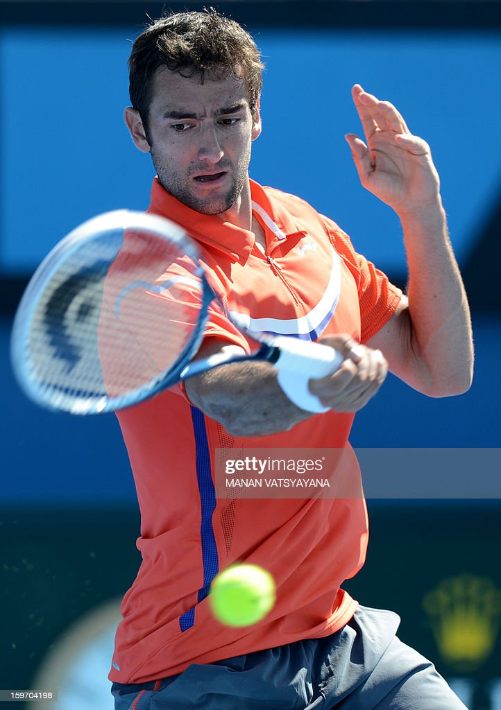 Croatia's Marin Cilic plays a return during his men's singles match against Italy's Andreas Seppi on the sixth day of the Australian Open tennis tournament in Melbourne on January 19, 2013.