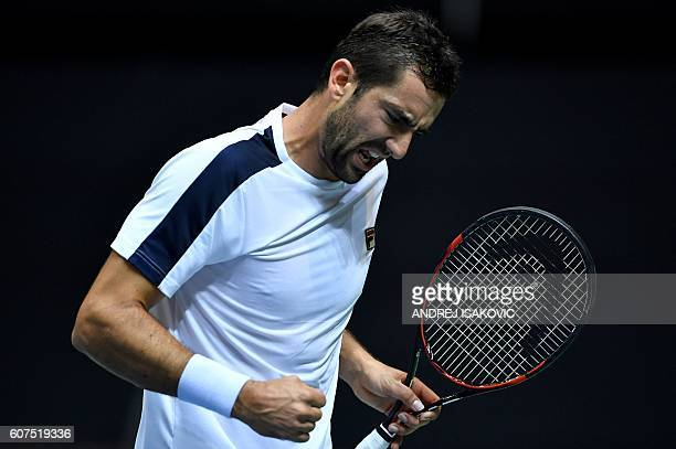 Croatia's Marin Cilic reacts after scoring against France's Richard Gasquet during the Davis Cup World Group semifinal singles match between Croatia...