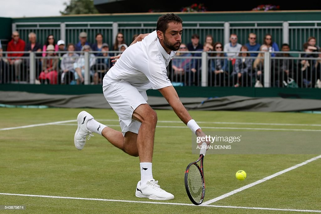 Croatia's Marin Cilic returns against Ukraine's Sergiy Stakhovsky during their men's singles second round match on the fourth day of the 2016 Wimbledon Championships at The All England Lawn Tennis Club in Wimbledon, southwest London, on June 30, 2016. / AFP / ADRIAN