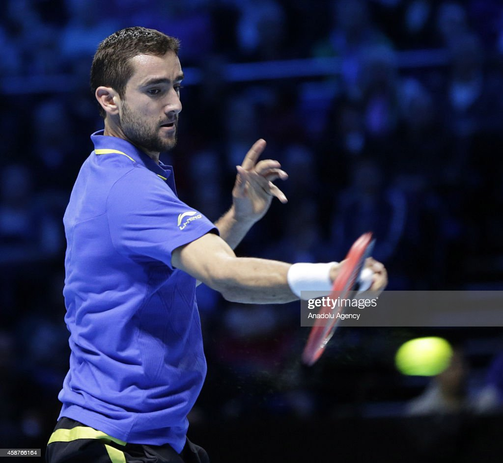 Croatia's Marin Cilic returns the ball to Serbia's Novak Djokovic during their Group A singles match on day two of the ATP World Tour Finals tennis tournament at O2 Arena in London, England on November 10, 2014.