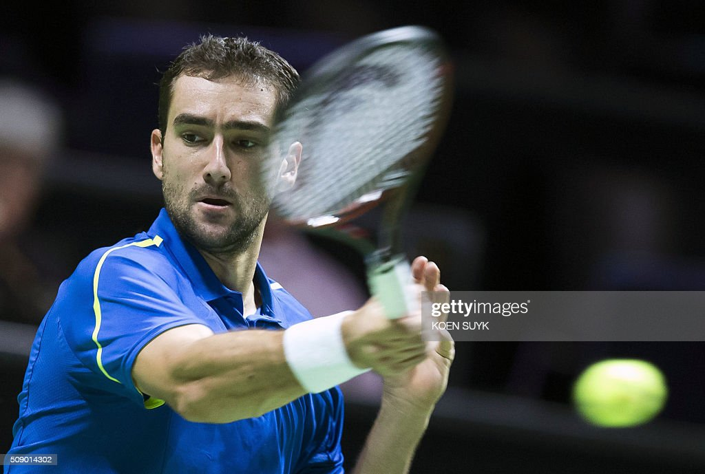 Croatia's Marin Cilic returns the ball to Uzbekistan's Denis Istominduring the first round of the ABN AMRO World Tennis Tournament on February 8, 2016 in Rotterdam. / AFP / ANP / Koen Suyk / Netherlands OUT